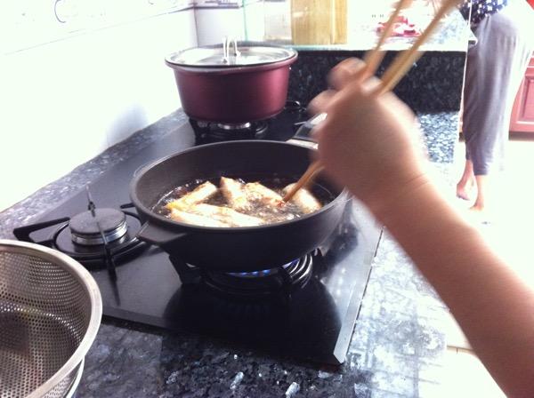 frying spring rolls